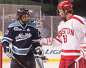 Ben Hutton (Maine - 10), Kevin Duane (BU - 18) - The University of Maine Black Bears defeated the Boston University Terriers 7-3 (2EN) on Saturday, January 11, 2014, at Fenway Park in Boston, Massachusetts.