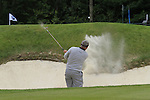 Darren Clarke (NIR) chips out of a greenside bunker at the 1st green during the Final Day of the BMW PGA Championship Championship at, Wentworth Club, Surrey, England, 29th May 2011. (Photo Eoin Clarke/Golffile 2011)