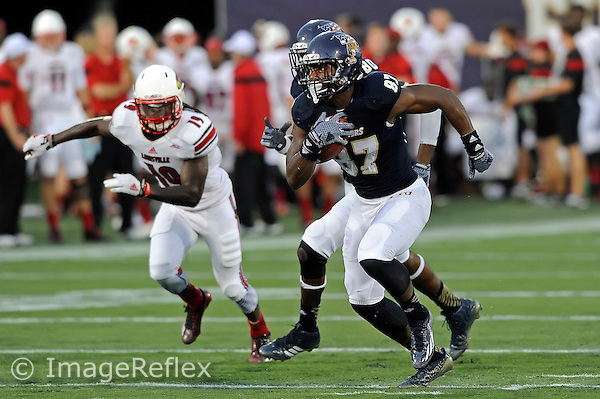 20 September 2014:  FIU tight end Jonnu Smith (87) attempts to evade Louisville cornerback Terell Floyd (19) in the second half as the University of Louisville Cardinals defeated the FIU Golden Panthers, 34-3, at FIU Stadium in Miami, Florida.