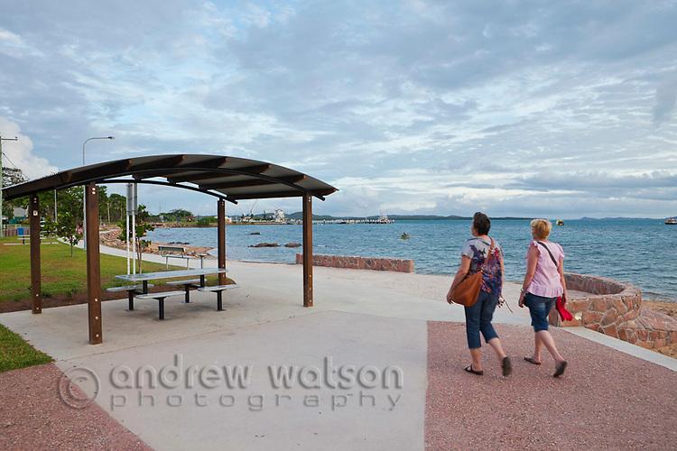 Tourists walking along the Victoria Parade foreshore.   Thursday Island, Torres Strait Islands, Queensland, Australia