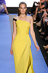 Alla walks runway in a cadmium yellow georgette one shoulder draped gown with exposed banded side detail, by Monique Lhuillier, from the Monique Lhuillier Spring 2012 collection fashion show, during Mercedes-Benz Fashion Week Spring 2012.