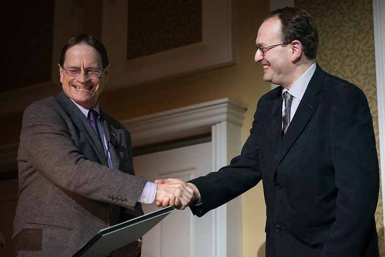 Ohio University's Interim President, David Descutner, awards Dr.  Alexander Govorov the 2017 Distinguished Professor Award at Ohio University's Baker Center Ballroom on Monday, February 20, 2017.