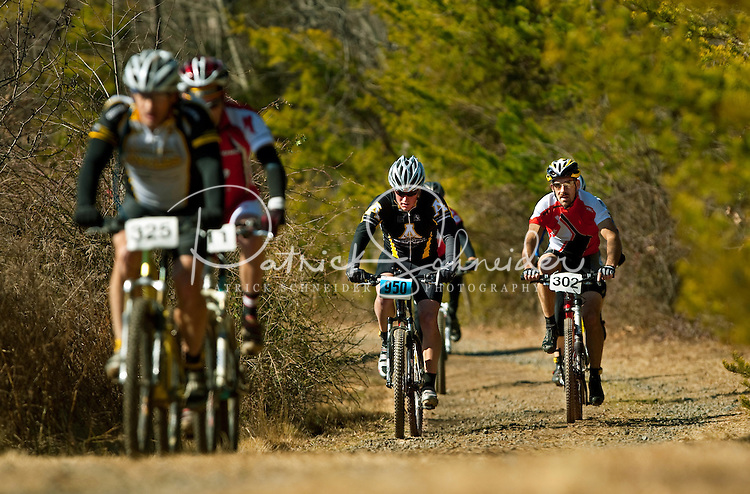 Photography from the Charlotte Mountain Bike racing group's Winter Short Track 2009 series at Charlotte North Carolina's Renaissance Park. The mountain biking short course is considered a unique style of racing in the Charlotte area. Short-track mountain bikers race on a 3/4 mile trail with bank turns. It's a cross between a criterium, BMX, cyclo-cross and single-track racing. The mountain bike event is very fast and spectator friendly. Renaissance Park Mountain Bike Trail is a six-mile long, single track loop with intermediate difficulty.