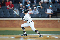 Michael Turconi (6) of the Wake Forest Demon Deacons follows through on his swing against the North Carolina State Wolfpack at David F. Couch Ballpark on April 18, 2019 in  Winston-Salem, North Carolina. The Demon Deacons defeated the Wolfpack 7-3. (Brian Westerholt/Four Seam Images)