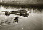 Diver investigates sinking oil truck - January 1982. Photograph by Liam McGrath