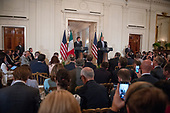 United States President Donald J. Trump, right, and Prime Minister Giuseppe Conte of Italy, left, hold a joint press conference in the East Room of the White House in Washington, DC on Monday, July 30, 2018.<br /> Credit: Ron Sachs / CNP