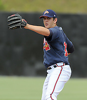 July 15, 2009: RHP Cory Rasmus (14) of the Danville Braves, rookie Appalachian League affiliate of the Atlanta Braves, prior to a game at Dan Daniel Memorial Park in Danville, Va. The former first round draft pick pitched a no-hitter Aug. 11, 2009. Photo by:  Tom Priddy/Four Seam Images.