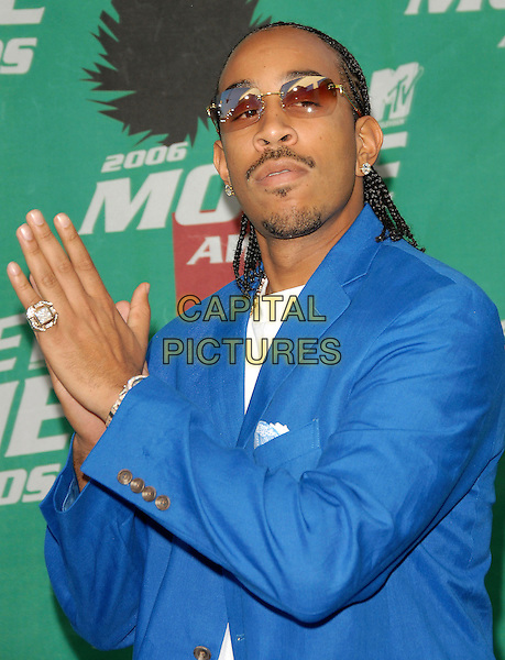 "CHRIS ""LUDACRIS"" BRIDGES.The 2006 MTV Movie Awards - Arrivals, held at The Sony Picture Studios in Culver City, Los Angeles, California, USA, June 3rd 2006..half length blue jacket clapping hands glasses ring.Ref: DVS.www.capitalpictures.com.sales@capitalpictures.com.©Debbie VanStory/Capital Pictures"