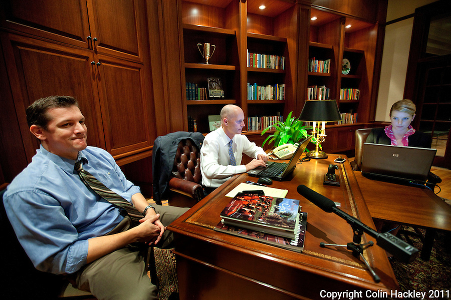 TALLAHASSEE, FLA. 1/20/11-SCOTT12011HACKLEY12-Gov. Rick Scott, center, responds to questions during a Twitter town hall meeting as Brian Burgess, left and Amy Graham, both of the communications office, join him Thursday at the Governor's Mansion in Tallahassee..COLIN HACKLEY PHOTO