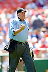 11 April 2006: Brian O'Nora, home plate umpire, holds the starting game ball prior to the Washington Nationals' Home Opener at RFK Stadium, in Washington, DC. The Mets defeated the Nationals 7-1 to maintain their early lead in the NL East...Mandatory Photo Credit: Ed Wolfstein Photo..