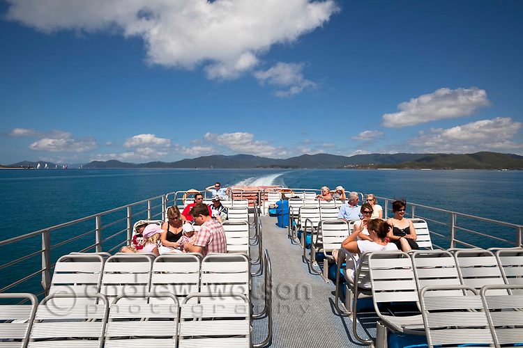 Passenger ferry crusing between the Whitsunday Islands.  Airlie Beach, Whitsundays, Queensland, Australia