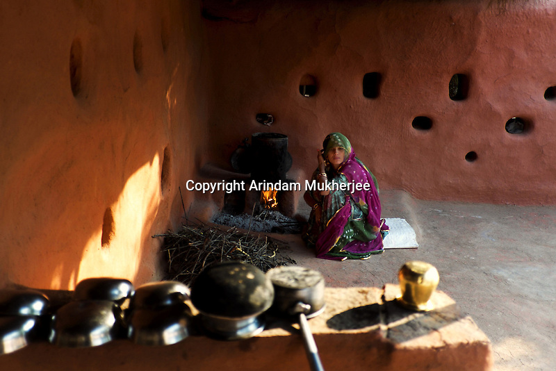 Bishnoi lady cooks at her home in Guda Bishnoi village near Jodhpur in Rajasthan, India. Arindam Mukherjee