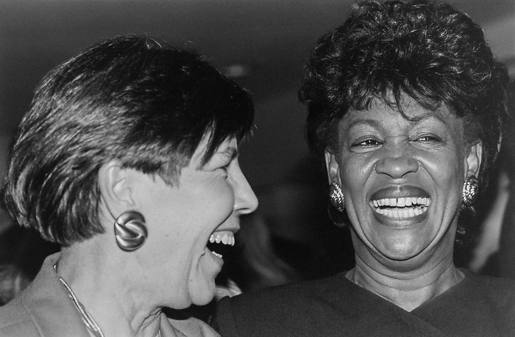 Rep. Elizabeth Furse, D-Ore., and Rep. Maxine Waters, D-Calif., at Defense Supply Center Columbus women's council reception dinner on Nov. 8, 1993. (Photo by Maureen Keating/CQ Roll Call)