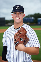 GCL Yankees East relief pitcher Shawn Semple (18) poses for a photo after the first game of a doubleheader against the GCL Blue Jays on July 24, 2017 at the Yankees Minor League Complex in Tampa, Florida.  GCL Blue Jays defeated the GCL Yankees East 6-3 in a game that originally started on July 8th.  (Mike Janes/Four Seam Images)