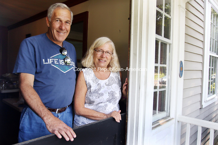 SOUTHBURY CT. 27 July 2017-073117SV02-Ed Edelson and his wife Christine Edelson stand in the doorway of  Cornucopia at Oldfield Bed and Breakfast in Southbury Monday.<br /> Steven Valenti Republican-American