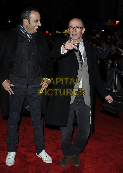 "ABDEL RAOUF DAFRI & JACQUES AUDIARD .At the ""About A Prophet"" Gala Screening during the Times BFI 53rd London Film Festival, Vue West End Leicester Square, London, England, UK, .October 24th 2009..full length glasses black coat finger pointing gesture tie jeans grey gray .CAP/CAN.©Can Nguyen/Capital Pictures"