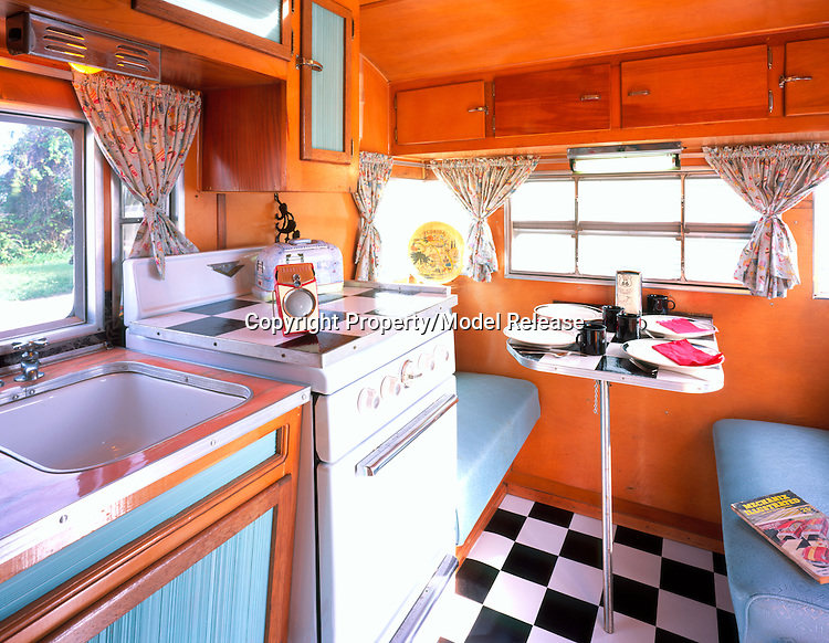 Kitchen interior of a 1957 Comet canned ham vintage travel trailer.