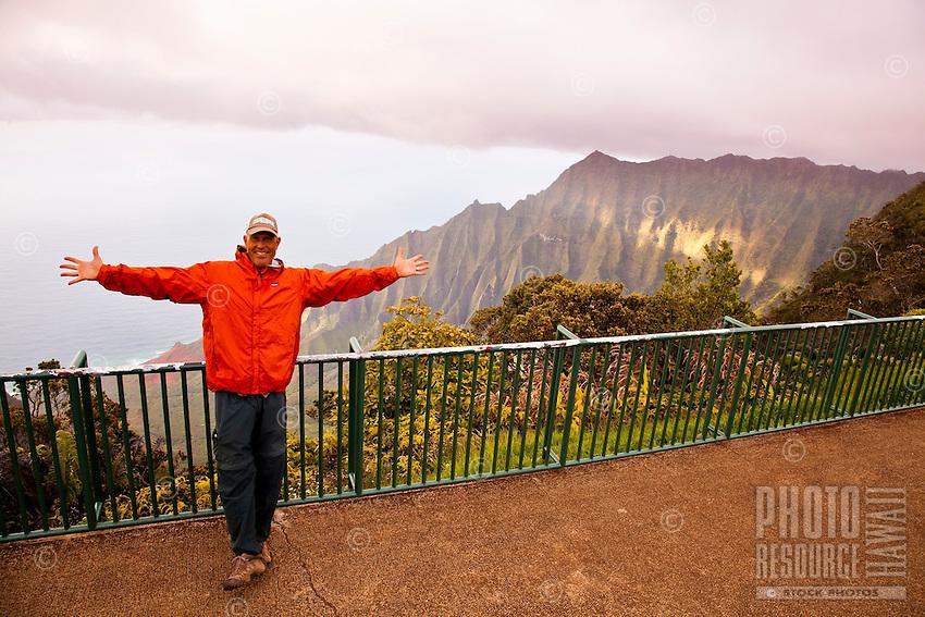 Man standing a Kalalau Valley overlook at Koke'e state park, Kauai