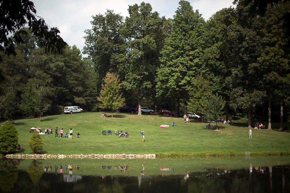 Men throw a football around near the pond during Oliver Winery's Harvest Wine Festival on Saturday, Sept.. 25, 2014. (Photo by James Brosher)