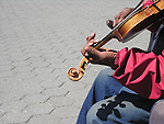 practice. makes,perfect, detail view man playing violin in public violin man