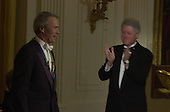 United States President Bill Clinton applauds Clint Eastwood at the Kennedy Center Honors reception in the East Room of the White House in Washington, D.C. on Sunday, December 3, 2000..Credit: Ron Sachs / Pool via CNP