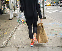 A woman with her groceries in New York on Sunday, June 5, 2016.  (© Richard B. Levine)