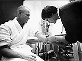Mercury astronaut John H. Glenn Jr. has a blood sample taken by Astronaut Nurse Delores B. O'Hara, R.N., in the Aeromedical Laboratory at Cape Canaveral, Florida on July 5, 1961. .Credit: NASA via CNP