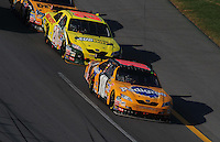 Oct 5, 2008; Talladega, AL, USA; NASCAR Sprint Cup Series driver Kyle Busch (18) leads Tony Stewart (20) during the Amp Energy 500 at the Talladega Superspeedway. Mandatory Credit: Mark J. Rebilas-