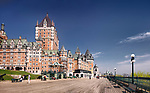 Panoramic view of Fairmont Le Château Frontenac castle and people on Dufferin terrace on a sunny day with deep blue sky, luxury grand hotel Chateau Frontenac, National Historic Site of Canada. Old Quebec City, Quebec, Canada. Terrasse Dufferin, Ville de Québec. Spring 2017.