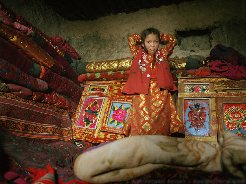 Naeem Man's sister waking up in the morning..Campment of Sary Tash..Winter expedition through the Wakhan Corridor and into the Afghan Pamir mountains, to document the life of the Afghan Kyrgyz tribe. January/February 2008. Afghanistan