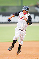 Tyler Saladino #1 of the Kannapolis Intimidators hustles towards third base against the Hickory Crawdads at Fieldcrest Cannon Stadium August 17, 2010, in Kannapolis, North Carolina.  Photo by Brian Westerholt / Four Seam Images