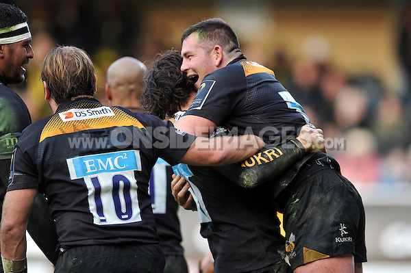 Edd Shervington of Wasps congratulates team-mate Ben Jacobs on his try. European Rugby Champions Cup match, between Wasps and Castres Olympique on December 14, 2014 at Adams Park in High Wycombe, England. Photo by: Patrick Khachfe / JMP