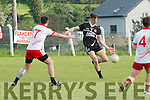 Ardfert's Iarla Courtney passing in the ball to his forward line.
