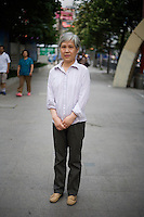 Xiexiaosu, retired, age 60, poses for a portrait in Nanjing. Response to 'What does China mean to you?': 'Same as previous page [her husband's response: The place I was born and grew up.]'  Response to 'What is your role in China's future? or What is China's role in the future?': 'Same as previous page. [her husband's response: A developing country. A peaceful society.]'