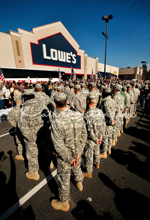 12/23/09: More than $10,000 in personal donations came in to bring the more than 200 members of the Fort. Mill Army National Guard home from their training post in Wisconsin- Lowe's chipped in the rest ($25,000). Two large buses arrived December 23, 2009, at Lowe's store # 2442 parking lot in Ft. Mill, S.C., and in Spartanburg S.C.
