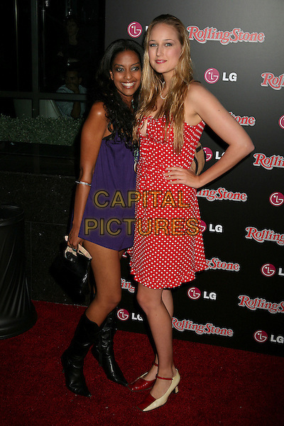 LEELEE SOBIESKI & GUEST.Rolling Stone Magazine Celebrates the 20th Annual HOT LIST at the Sofitel Hotel's Stone Rose Lounge, Los Angeles, California, USA..October 3rd, 2006.Ref: ADM/BP.full length purple black boots dress red white polka dot hand on hip.www.capitalpictures.com.sales@capitalpictures.com.©Byron Purvis/AdMedia/Capital Pictures.