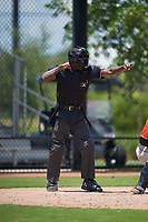 Umpire Jaylen Goodman calls a strikeout during a Gulf Coast League game between the GCL Astros and GCL Nationals on August 9, 2019 at FITTEAM Ballpark of the Palm Beaches training complex in Palm Beach, Florida.  GCL Nationals defeated the GCL Astros 8-2.  (Mike Janes/Four Seam Images)