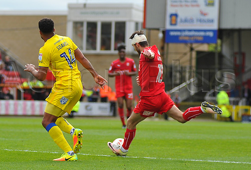April 14th 2017, County Ground, Swindon, Wiltshire; Skybet league 1 football, Swindon Town versus AFC Wimbledon; John Goddard, midfielder for Swindon Town takes a shot at goal blocked by Tom Soares, midfielder of AFC Wimbledon