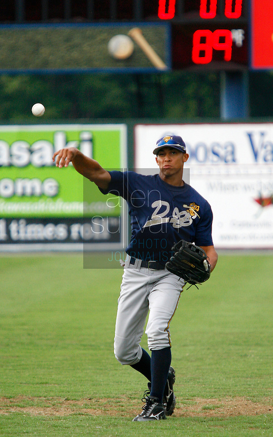 Tim Battle, a New York Yankees prospect from McIntosh High School in Peachtree City, warms up before his team, the Charleston Riverdogs, played the Rome Braves in Rome, Ga. on Friday, July 14, 2006. Battle said he's been in full remission from lymphoma since 2003.<br />