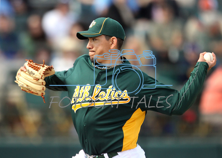 Oakland A's pitcher Brian Fuentes throws in a Cactus League preseason game between the Dodgers and the A's in Scottsdale, Ariz., on Wednesday, March 7, 2012. The game ended 3-3..Photo by Cathleen Allison