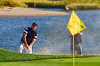 Phil Mickelson (USA) chips on to 14 during round 1 foursomes of the 2017 President's Cup, Liberty National Golf Club, Jersey City, New Jersey, USA. 9/28/2017.<br /> Picture: Golffile   Ken Murray<br /> ll photo usage must carry mandatory copyright credit (&copy; Golffile   Ken Murray)