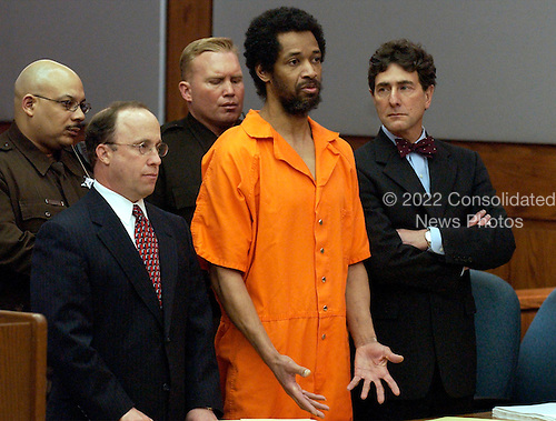 Manassas, VA - March 9, 2004 -- Convicted Beltway John Allen Muhammad, center, addresses the court along with his attorneys Peter Greenspun, left, and Jonathan Shapiro, right, prior to being sentenced to death for the shooting of Dean Meyers at the Prince William County (Virginia) Circuit Court in Manassas, Virginia on March 9, 2004.  A Virginia Beach, Virginia  jury convicted Muhammad and recommended the death sentence for his role in the fall, 2002 DC Sniper shootings. .Credit: Steve Helber - Pool via CNP