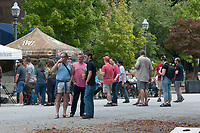 NWA Democrat-Gazette/J.T. WAMPLERn Representatives from Arkansas breweries give out samples Sunday Oct. 7, 2018 at the Arkansas Brewers Guild's Oktoberfest celebration on the Fayetteville Square. The community event feature beer sampling, games and live music. For more information about the Arkansas Brewers Guild visit their Facebook page.