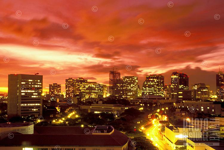 Downtown Honolulu skyline at sunset.