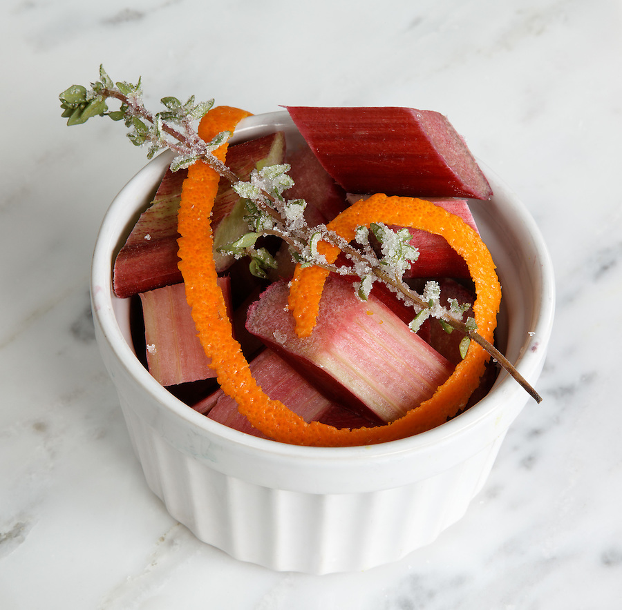 Chopped rhubarb in bowl garnished with orange peel and lavender sprig, by pastry chef Laurie Pfalzer, Pastry Craft