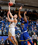 SIOUX FALLS, SD - NOVEMBER 28: Mike Daum #24 from South Dakota State University takes the ball tot he basket past Jamel Allen #13 from UMKC during their game Wednesday night at Frost Arena in Brookings, SD. (Photo by Dave Eggen/Inertia)
