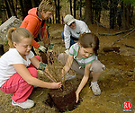 TORRINGTON, CT- 26 APRIL 2008 --042608JS02-Gilr Scout vounteers Cara McCarthy, 9, left and Jennifer Friscia, 9, right, both members of Torrington Girl Scout Troop 59, help plant trees and shrubs along the Sue Grossman Still River Greenway in Torrington on Saturday. Also helping with the planting were Linda Beyus, a member of the Torrington Conservation Commission, back left , and Dennis Andrews, a member of the Greenway Committee. The planting was part of an Earth Day celebration. The trees and shrubs being planted were donated by the Torrington Conservation Commission. <br /> Jim Shannon / Republican-American