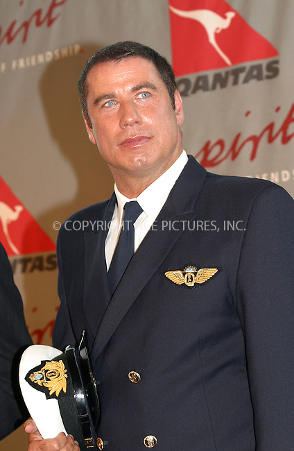 """Actor John Travolta has become an Ambassador-at-Large for Australian airline company, Qantas. Travolta's relationships with the Qantas started when he boutght Boeing 707 from  the airline company four years ago. It further developed when Travolta went through the training program and successfully completed 747-400 First Officer simulator training. Now, John Travolta is on the """"Spirit of Friendship"""" tour around the globe flying his own Boeing 707 painted in original Qantas 1960s branding and livery. Mr. Travolta who is the pilot and the first officer, promotes Qantas because of the company's outstanding safety record and outstanding service. JFK Airport, New York, August 28, 2002. Please byline: Alecsey Boldeskul/NY Photo Press.   ..*PAY-PER-USE*      ....NY Photo Press:  ..phone (646) 267-6913;   ..e-mail: info@nyphotopress.com"""