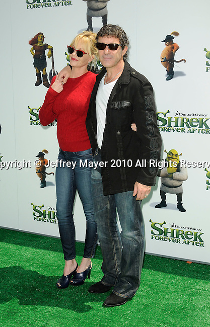 "UNIVERSAL CITY, CA. - May 16: Melanie Griffith and Antonio Banderas arrive at the ""Shrek Forever After"" Los Angeles Premiere at Gibson Amphitheatre on May 16, 2010 in Universal City, California."