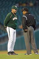 Baylor Bears head coach Steve Smith #34 discusses a call with first base umpire Jesse Moreno during game action versus the Rice Owls in the 2009 Houston College Classic at Minute Maid Park March 1, 2009 in Houston, TX.  The Owls defeated the Bears 8-3. (Photo by Brian Westerholt / Four Seam Images)